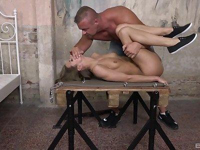 Muscular bloke fucks slave girl plus comes on her cunt