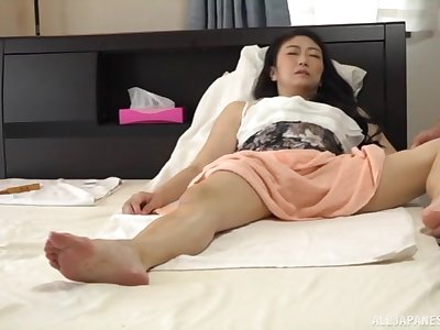 Pale mature Japanese MILF has her pussy massaged and fingered