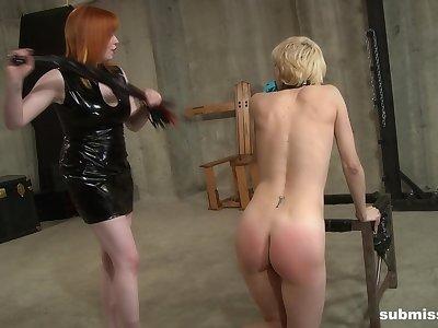 Mature redhead Mistress Irony abuses her blonde teen slave girl Ava