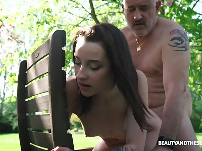 Nympho Charlotte Johnson is spying on naked old neighbor in be imparted to murder garden